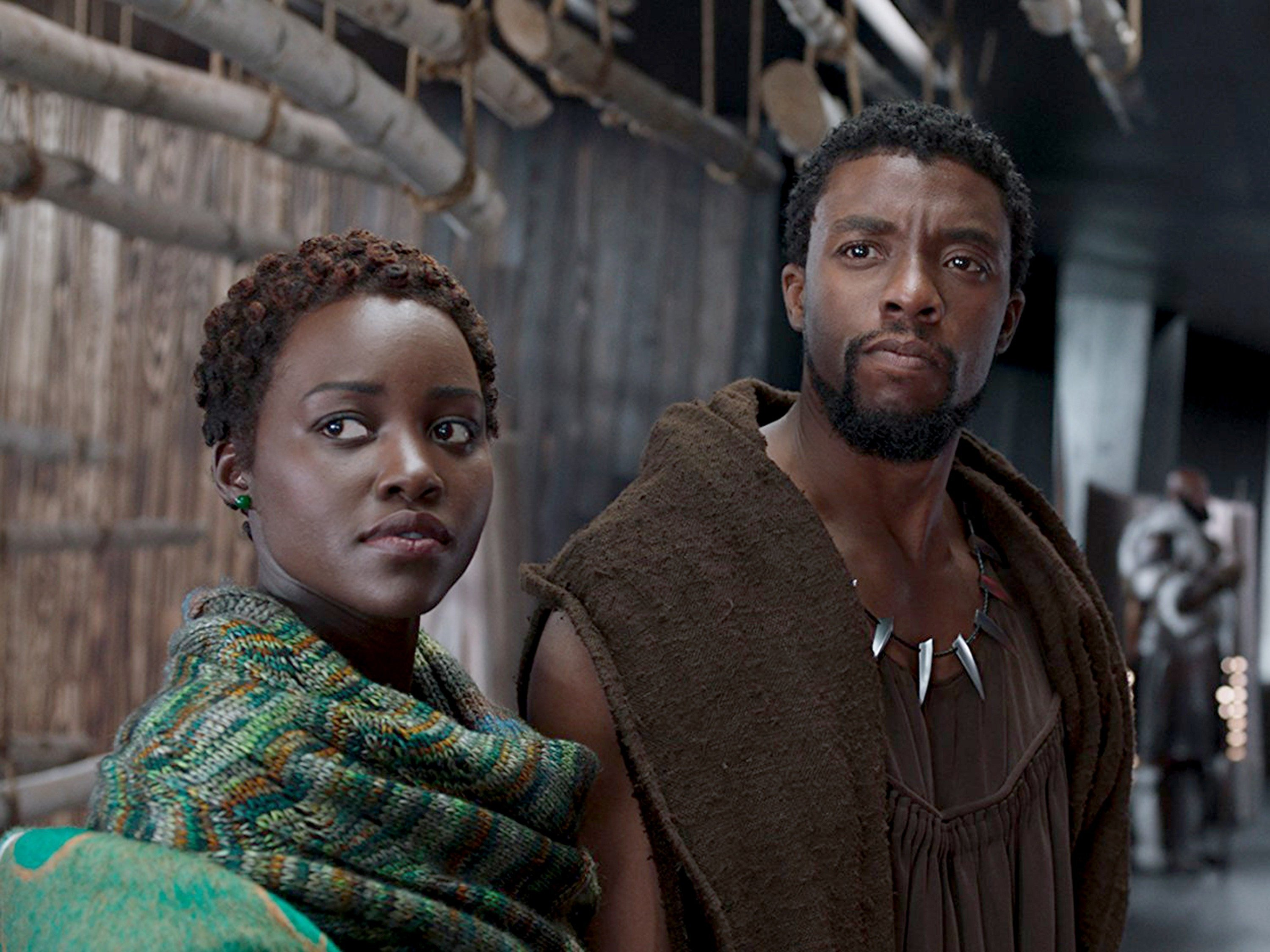 """Black superheroes have reached the screen before, but seeing the collective weight of Marvel/Disney thrown behind a blockbuster like """"Black Panther"""" still feels like a cultural watershed, one that the movie exuberantly embraces."""