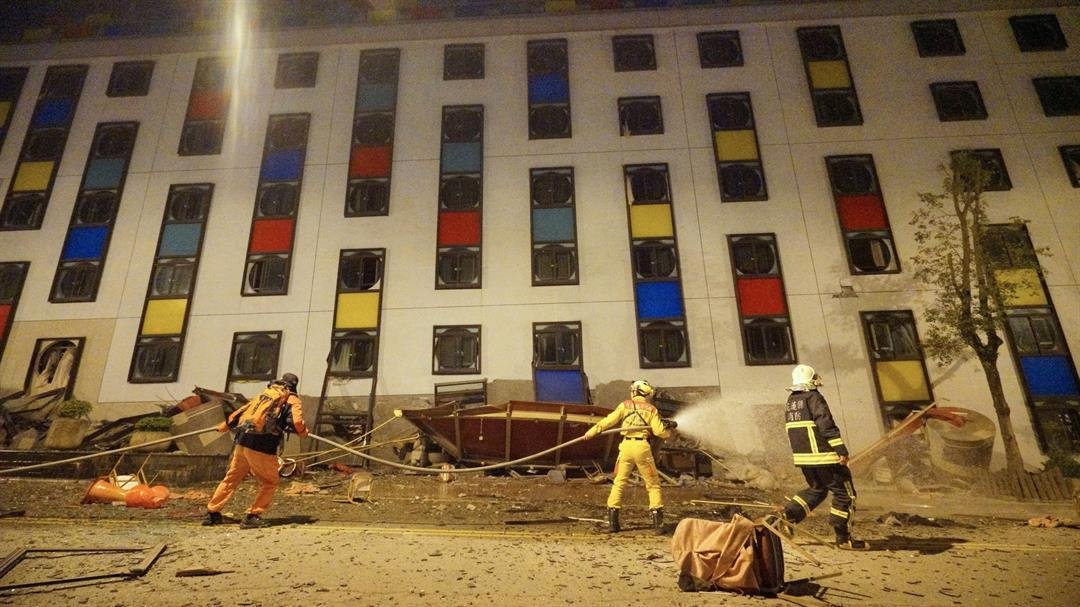 Rescure workers search the damaged Marshal Hotel in Hualien, eastern Taiwan, early February 7, 2018, after a strong earthquake struck the islan