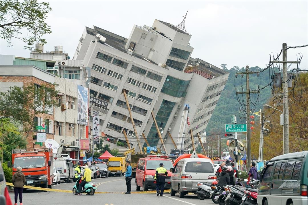 Emergency workers block off a street in the Taiwanese city of Hualien where a building threatens to collapse after a 6.4 magnitude quake.