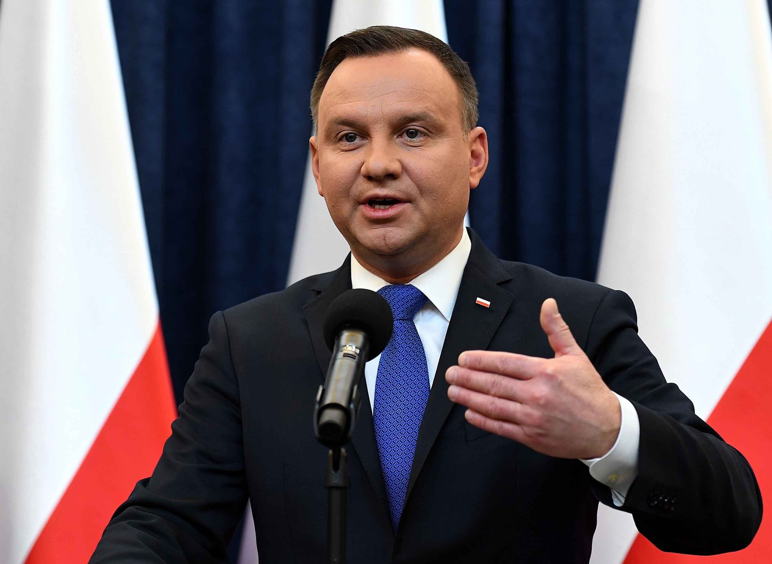 Full credit: Janek Skarzynski/AFP/Getty Images  Poland's President Andrzej Duda gives a press conference to announce that he will sign into law a controversial Holocaust bill.