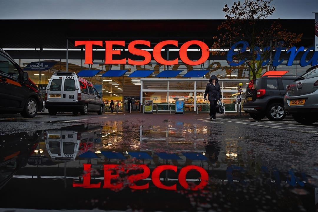 A group of 100 mostly female store workers has accused supermarket chain Tesco of paying them as much as £100 ($140) a week less than employees in its distribution centers.