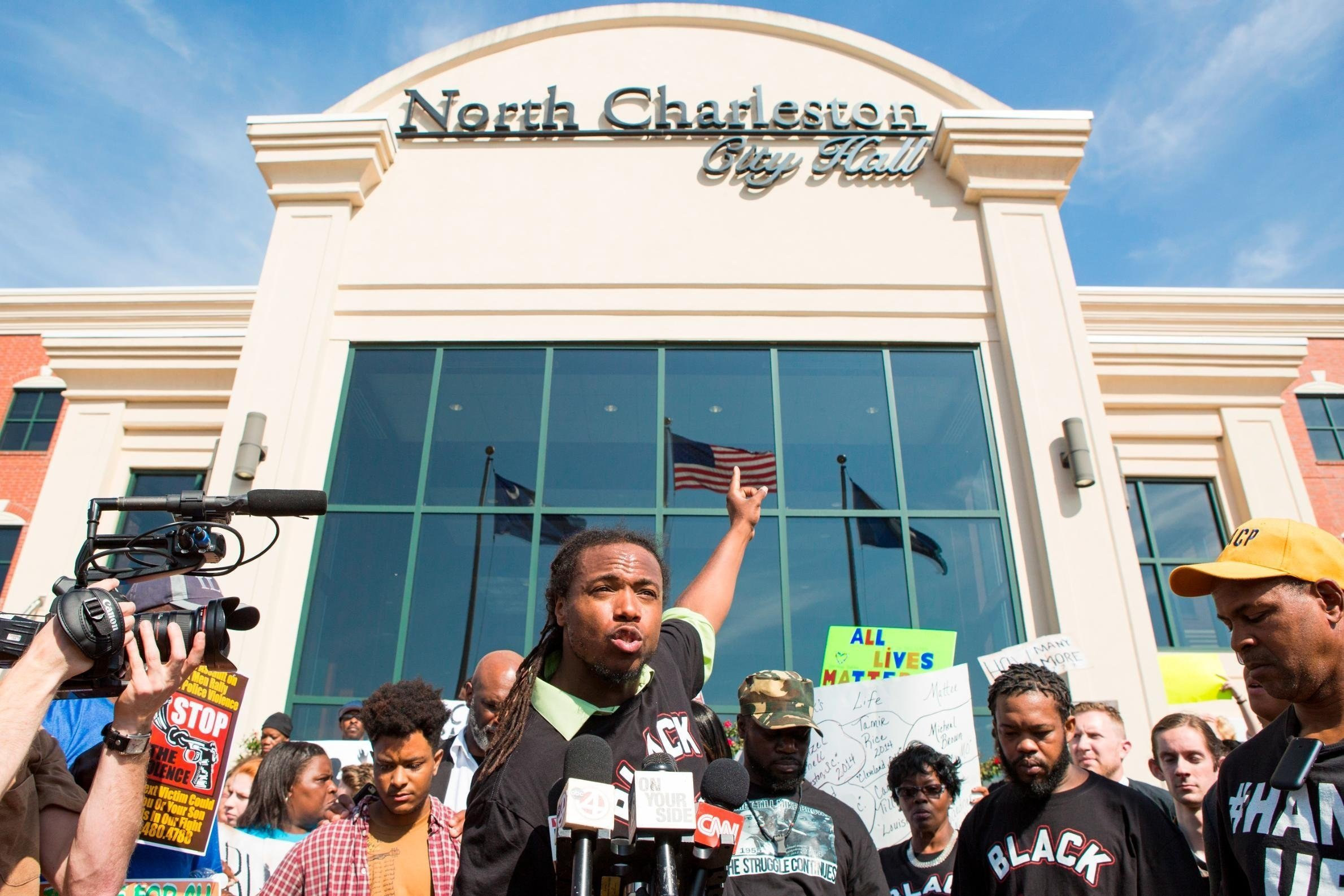 Full credit: Alex Holt/The Washington Post/Getty Images  Muhiydin Moye addresses the crowd at a 2015 Walter Scott demonstration in North Charleston.