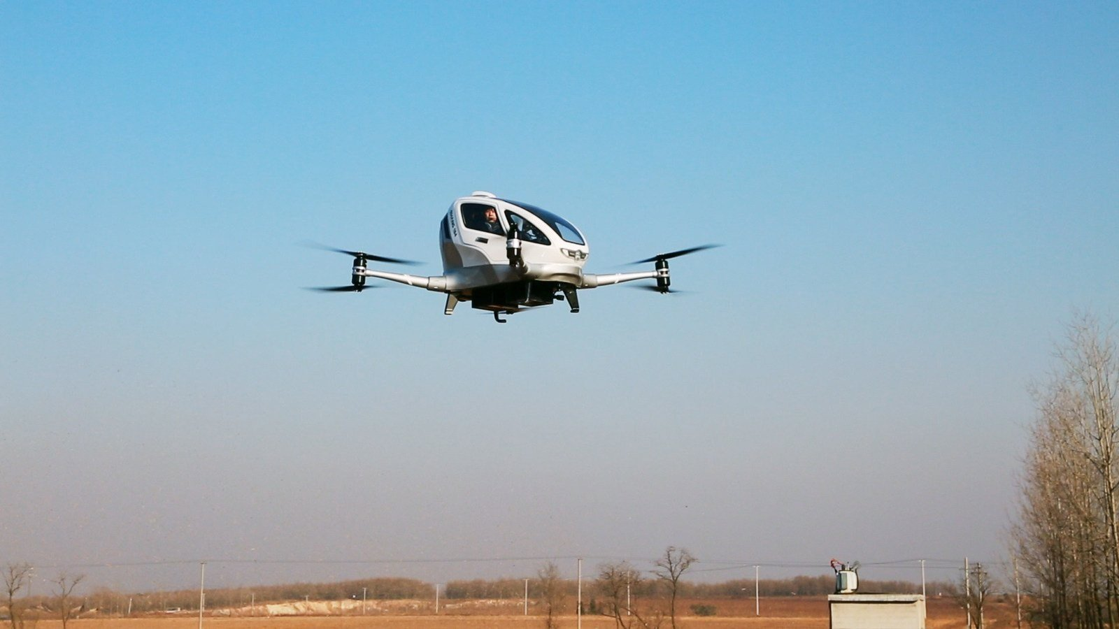 EHANG CEO Hu Huazhi conducts a manned test flight on the EHANG 184 drone.