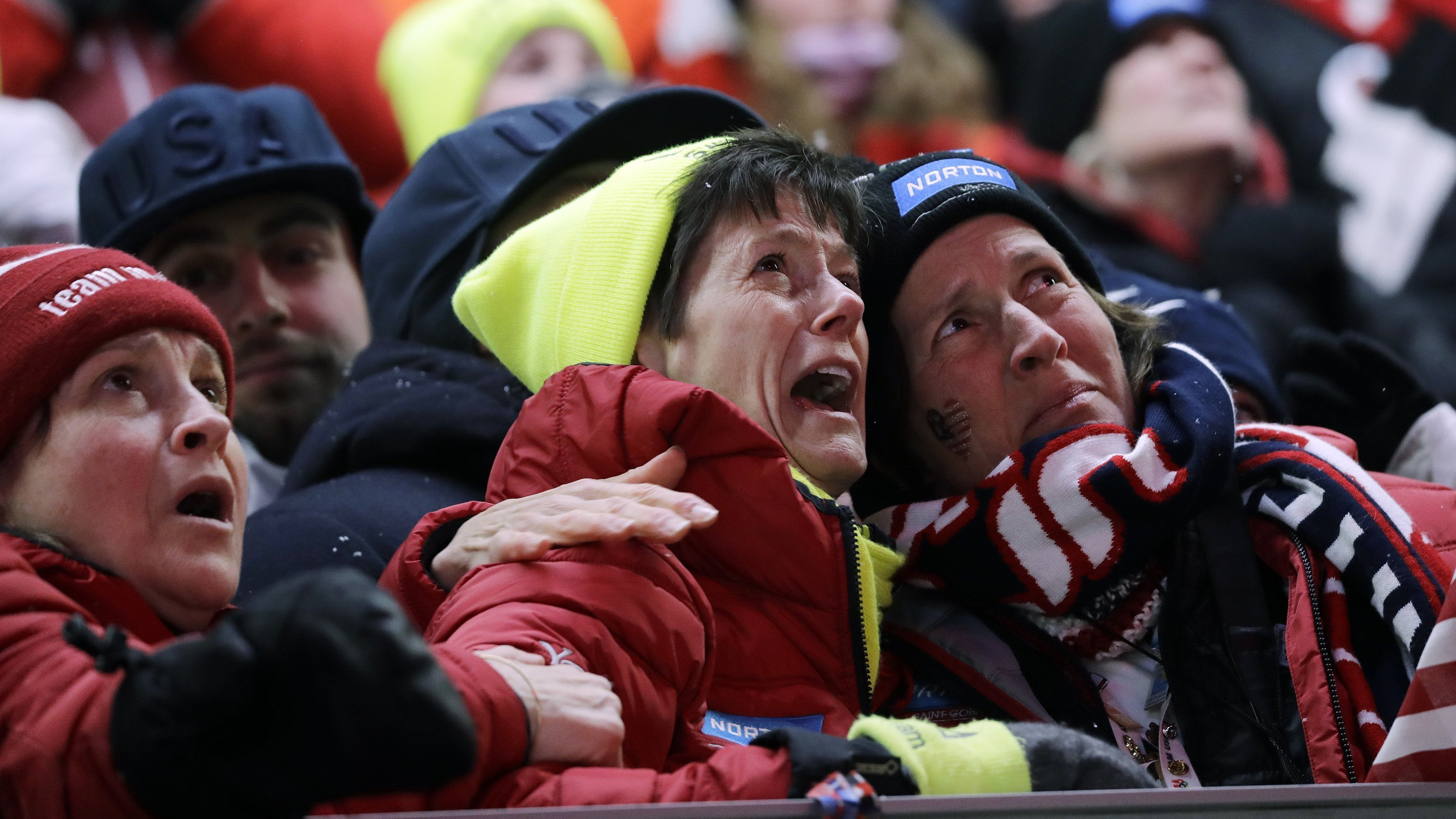 Sue Sweeney, center, the mother of Emily Sweeney of the United States, cries out as her daughter crashes on the final run during the women's luge final