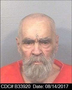 Nearly three months after his death, Charles Manson's body is still on ice in Kern County, California, as at least four people fight to claim his body.