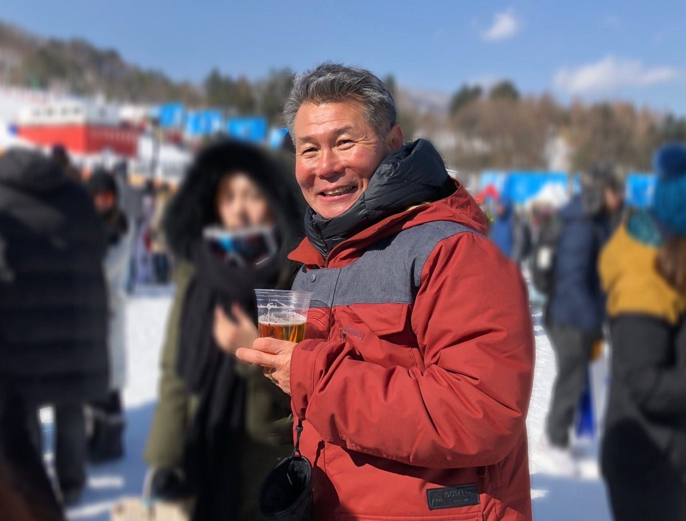 Chloe Kim's father, Jong Jin Kim, celebrating his daughter's Olympic's win with a cold beer.