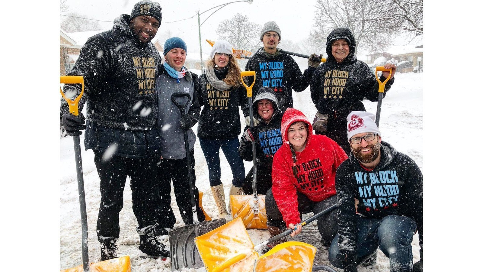 Volunteers help shovel snow for the elderly on the South Side of Chicago.