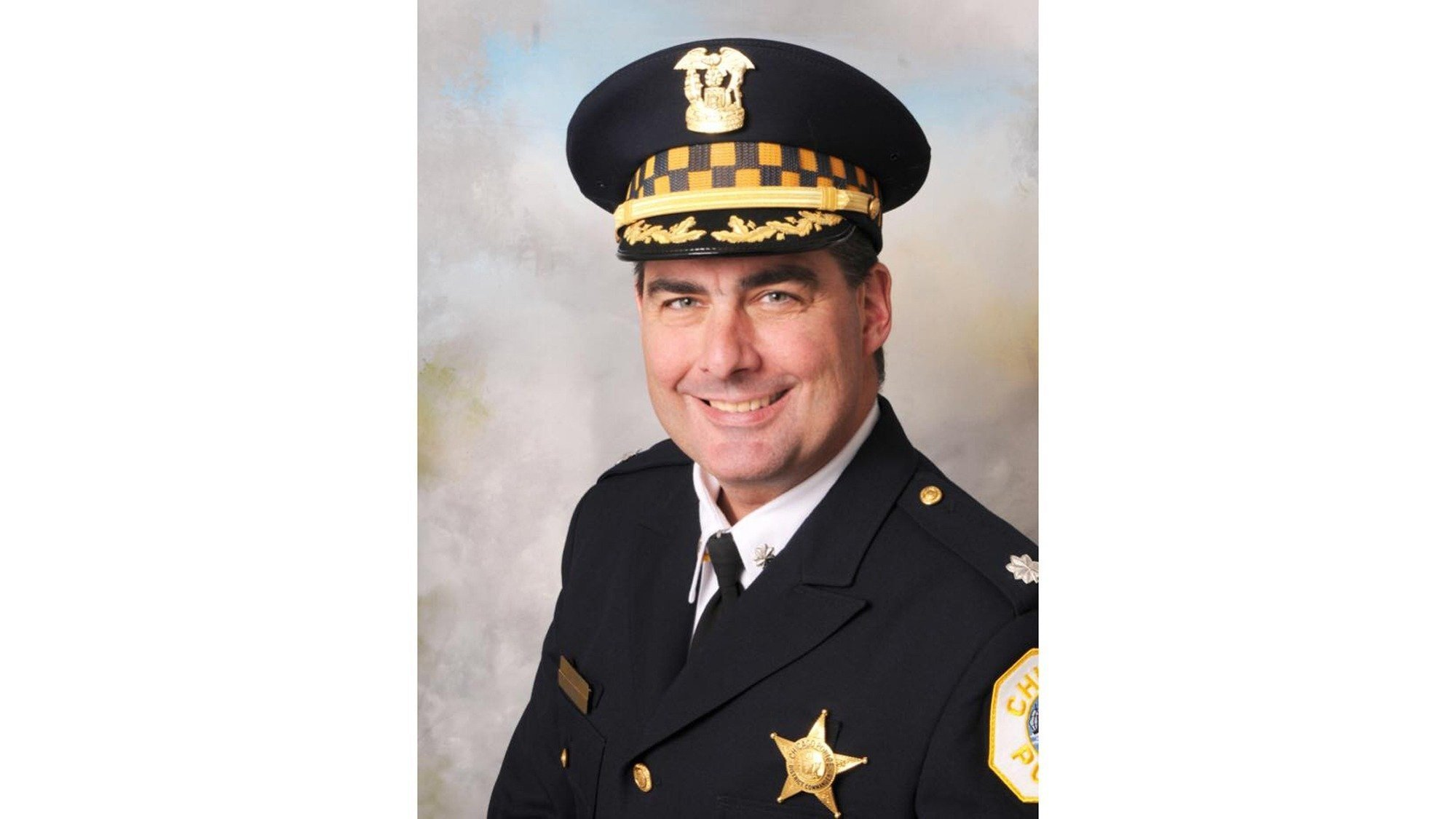 An off-duty police commander who responded to a call was fatally shot Tuesday in downtown Chicago, the city's top officer said.