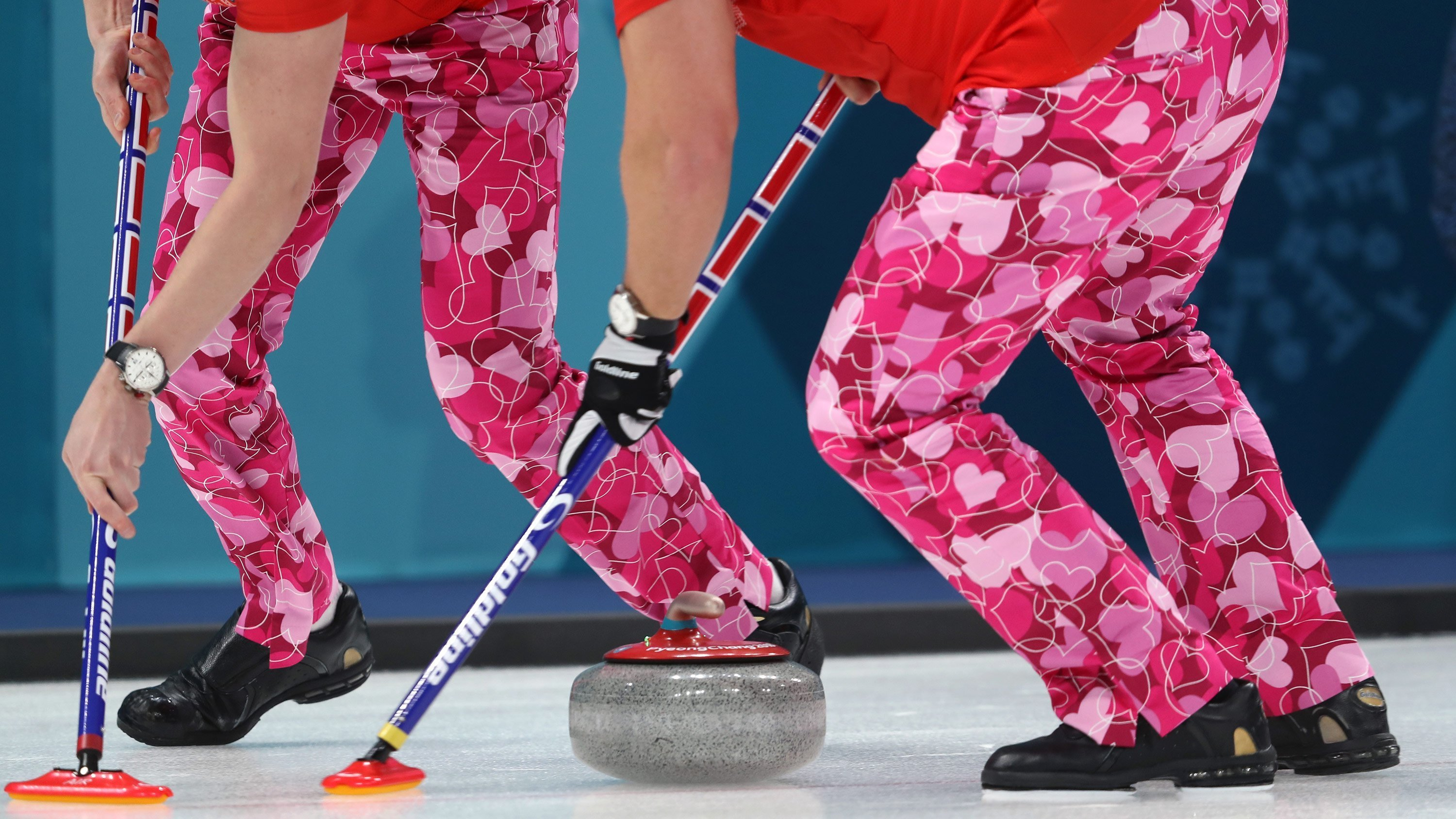 Norway's curlers wear special pink trousers for Valentine's Day