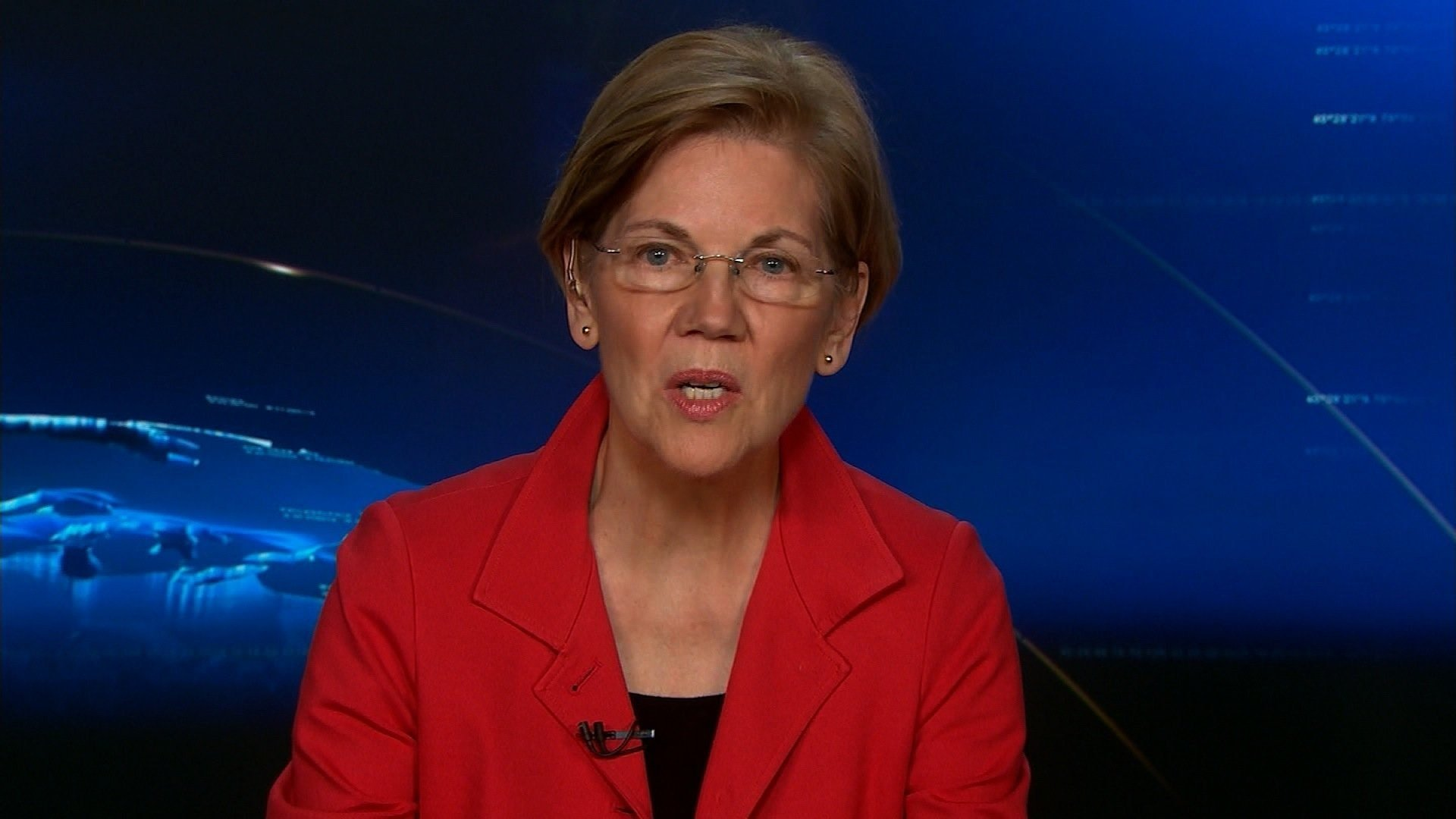 """File- Massachusetts Sen. Elizabeth Warren defended her claims of Native American heritage and responded to the nickname President Donald Trump uses to refer to her -- """"Pocahontas"""" -- in a surprise appearance Wednesday at a National Congress of American..."""