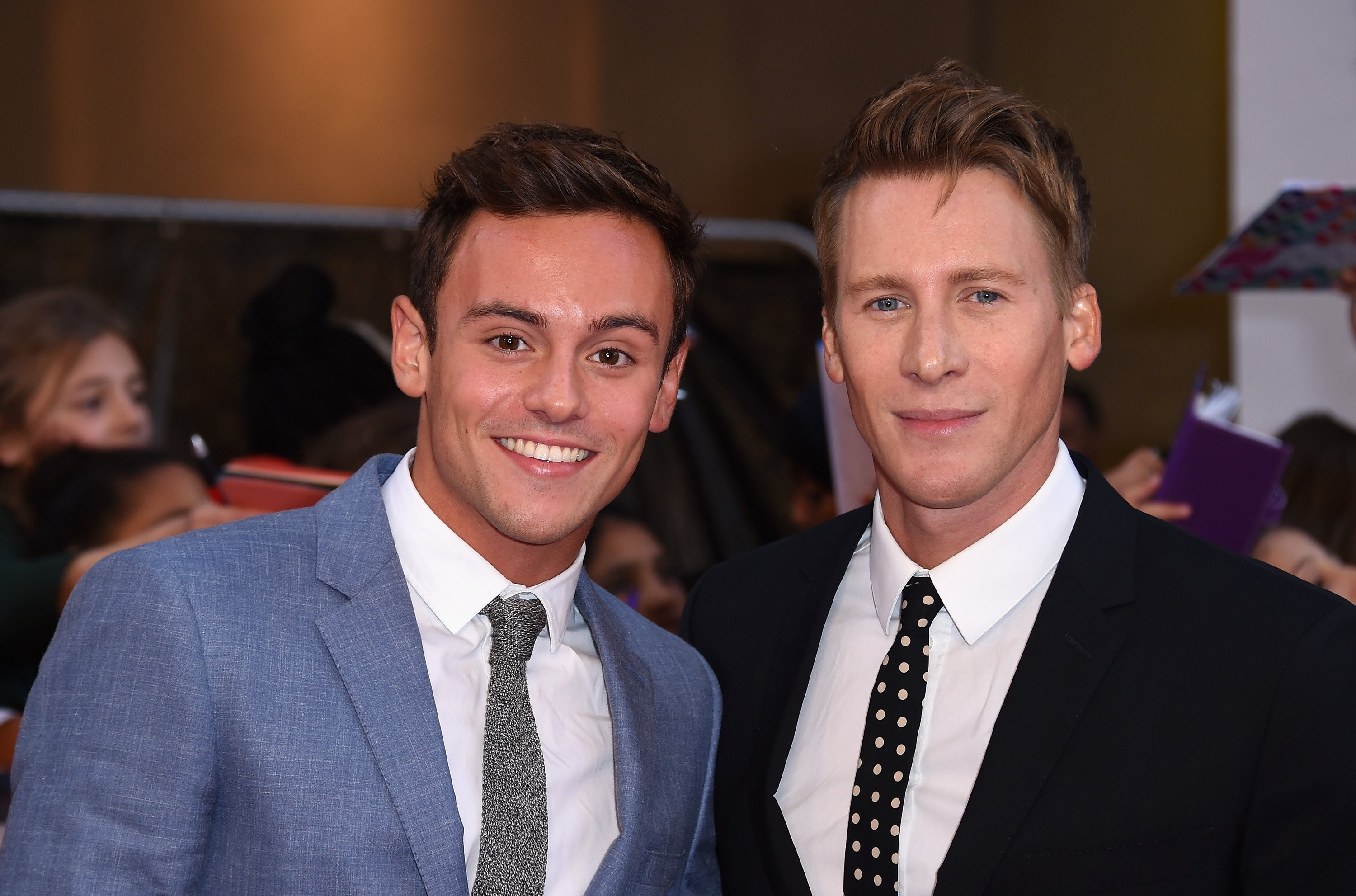 Tom Daley is taking a dive into parenthood. The Olympic diving medalist announced on Wednesday that he and his husband, Dustin Lance Black, are having a baby. Daley, 23, posted a photo of himself and Black, 43, on Instagram holding an ultrasound image...