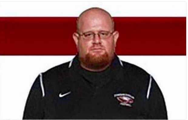 Florida high school coach hailed a hero after 'shielding students from bullets'