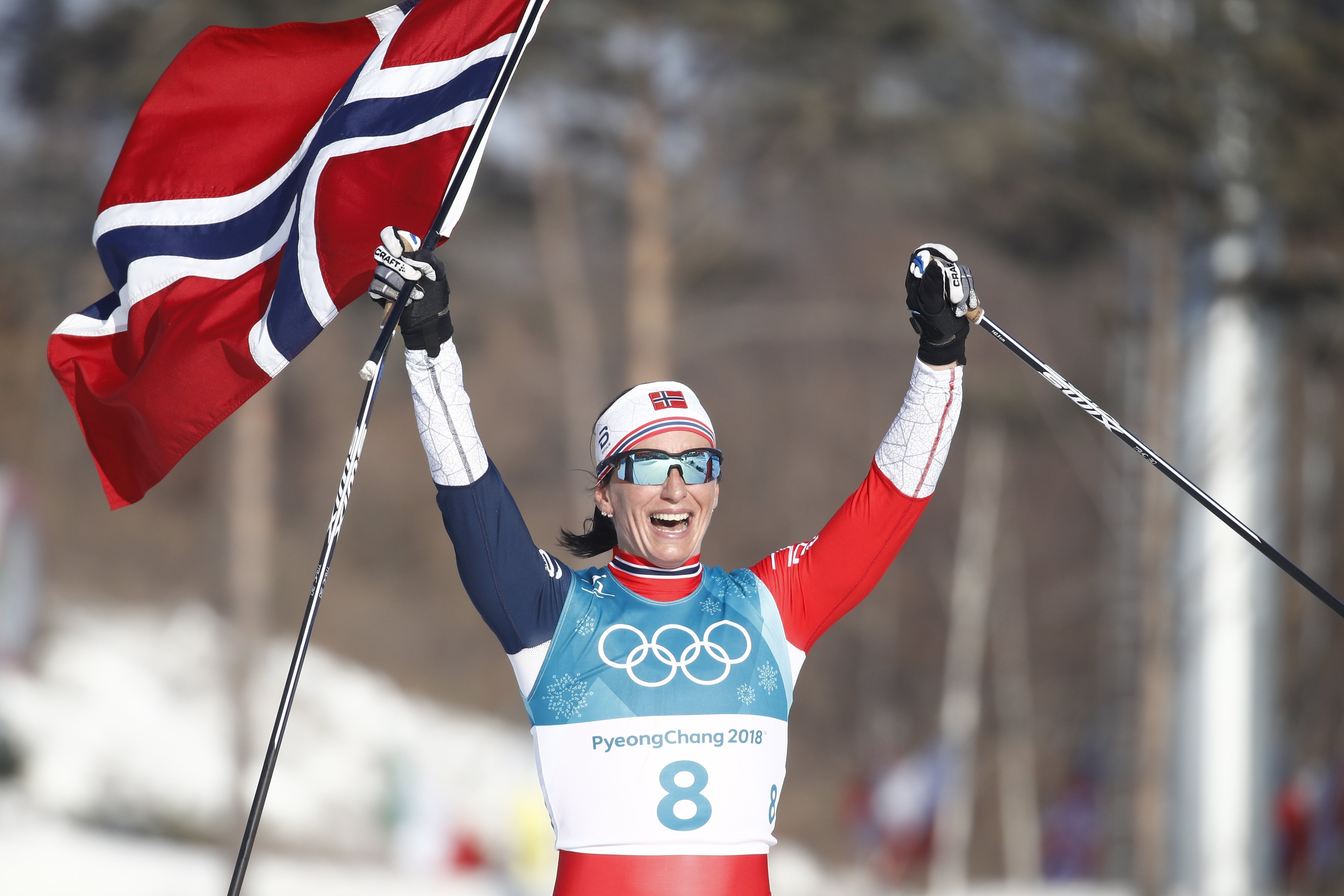 Winter Olympics: Marit Bjoergen puts Norway top of the medals table