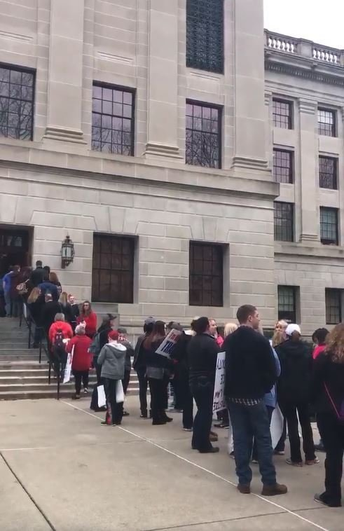 After a tense weekend without talks, West Virginia's public school teachers resumed their strike on Monday, February 26, 2018-- closing schools for a third day -- and state officials said they may consider an injunction to stop the walkout.