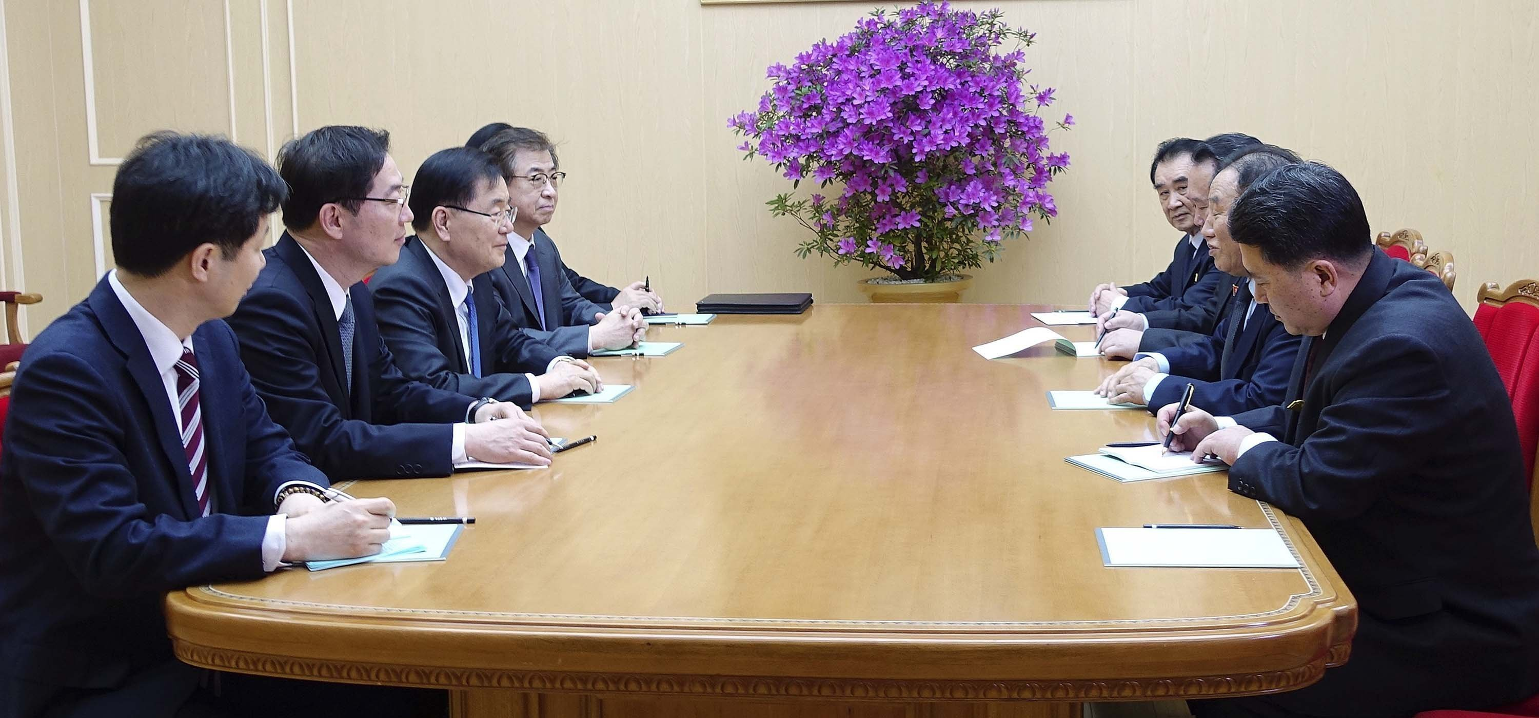 In this photo provided by South Korea Presidential Blue House Monday, South Korean national security director, Chung Eui-yong, third from left, meets with North Korean vice chairman of North Korea's ruling Workers' Party Central Committee, Kim Yong...