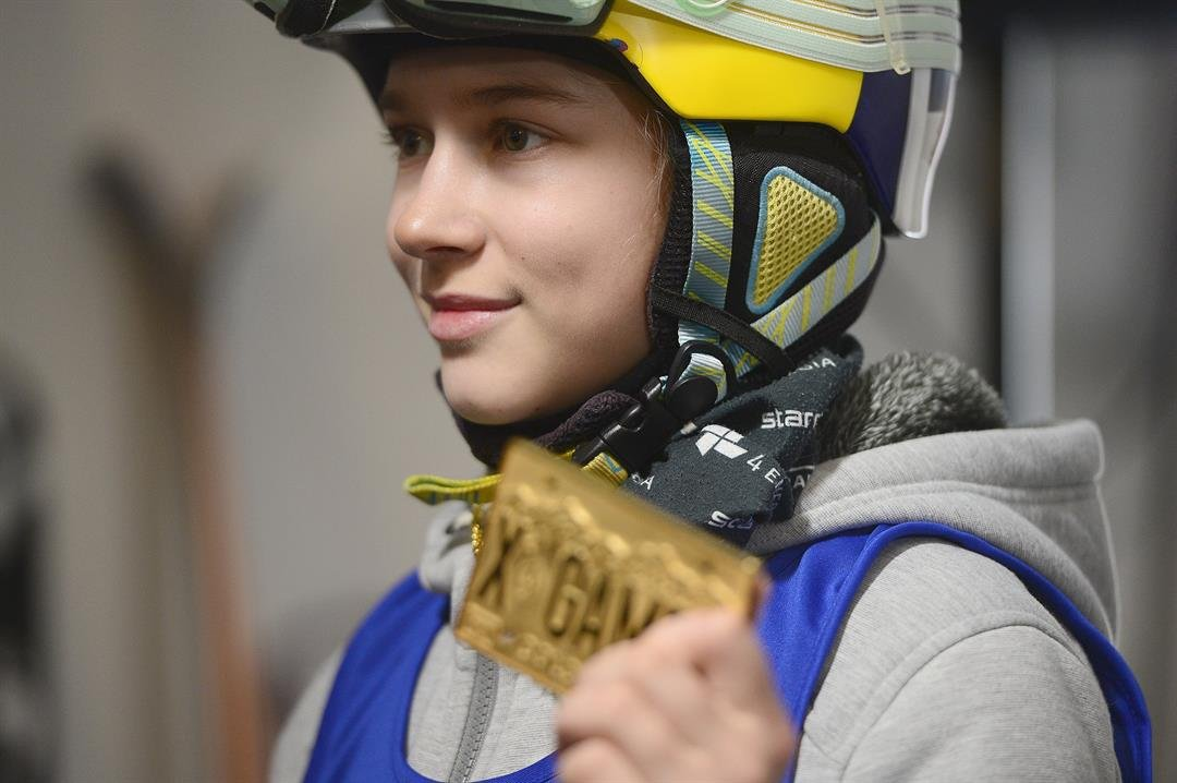 Kelly Sildaru holds aloft her X Games gold medal at Buttermilk Mountain in Aspen, aged 13.   CREDIT: Brent Lewis/Denver Post via Getty Images