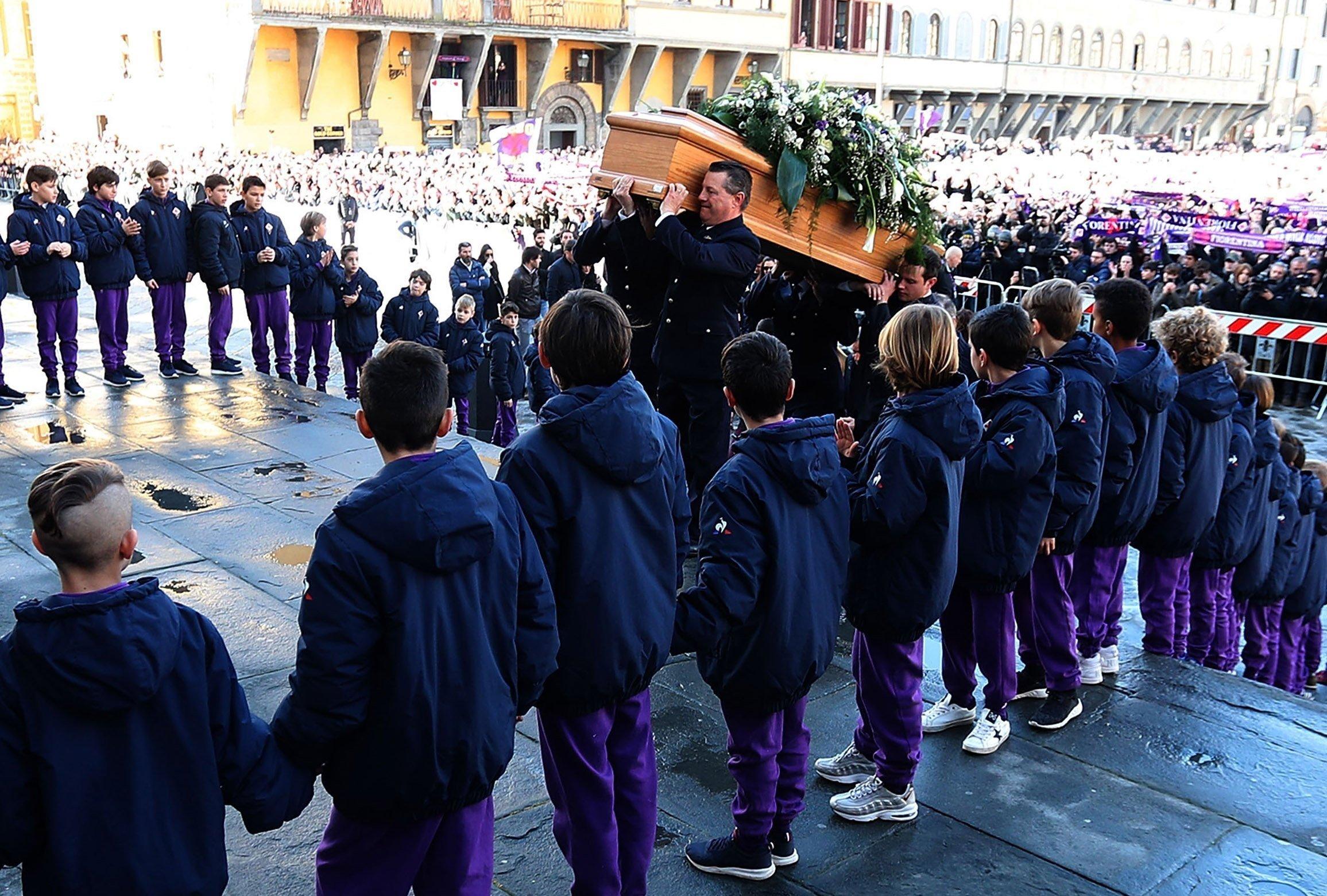 The coffin of Fiorentina captain Davide Astori is carried into the Basilica di Santa Croce Thursday, March 8, 2018.