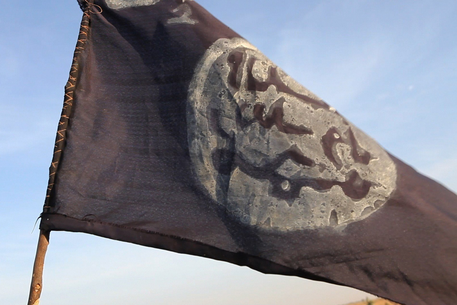 **This image is for use with this specific article only.**  A Boko Haram flag flutters from an abandoned command post in the border town of Gamboru, Nigeria.
