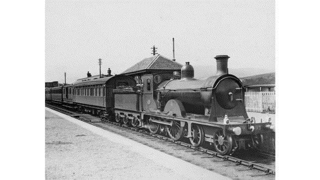 Scottish sleeper trains have been traveling up and down the country for almost 150 years. Pictured here: A North British Railway passenger train waits at Spean Bridge station, in around 1900.  CREDIT: Courtesy David Meara's collection/Amberley Books