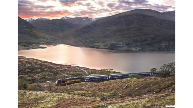 The journeys have stunning scenery en route. Pictured here: The southbound Fort William -- London Euston Sleeper passing the head of Loch Treig, between Tulloch and Corrour.  CREDIT: Courtesy Norman McNab/Amberley Books