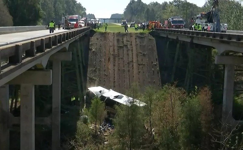 **Embargo: Mobile, AL-Pensacola, FL**  A First Class Tours charter bus carrying high school band students from Channelview, Texas, lies in a ravine where it crashed off I-10 in Baldwin County, Alabama.
