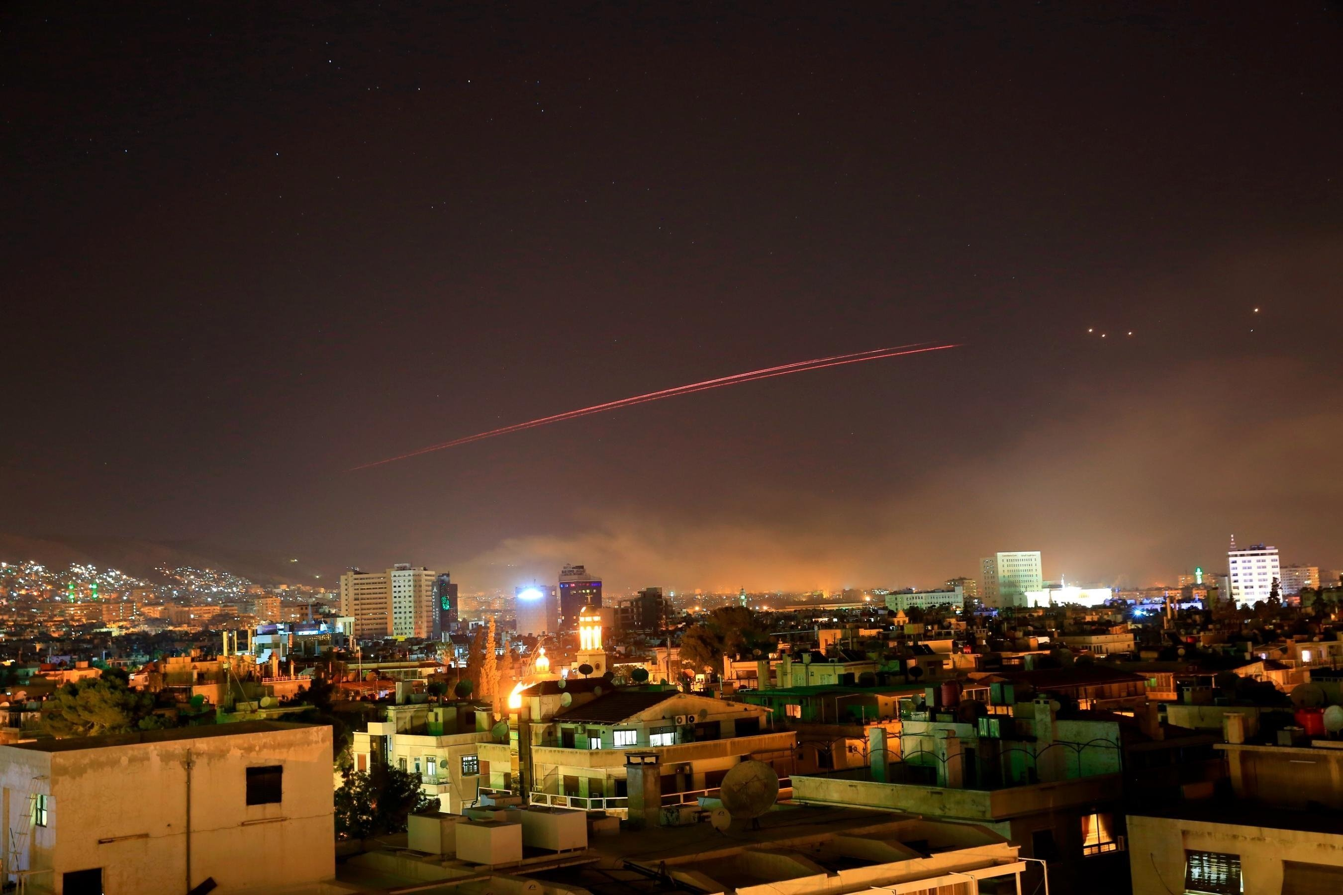 Damascus skies erupt with anti-aircraft fire as the US launches an attack on Syria targeting different parts of the Syrian capital Damascus, Syria, early Saturday, April 14, 2018.