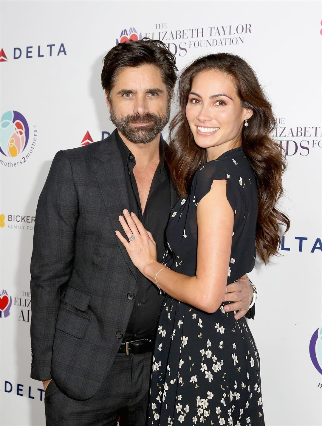 John Stamos and actress Caitlin McHugh welcomed a  newborn son.   CREDIT: Rachel Murray/Getty Images for mothers2mothers and The Elizabeth Taylor AIDS Foundation