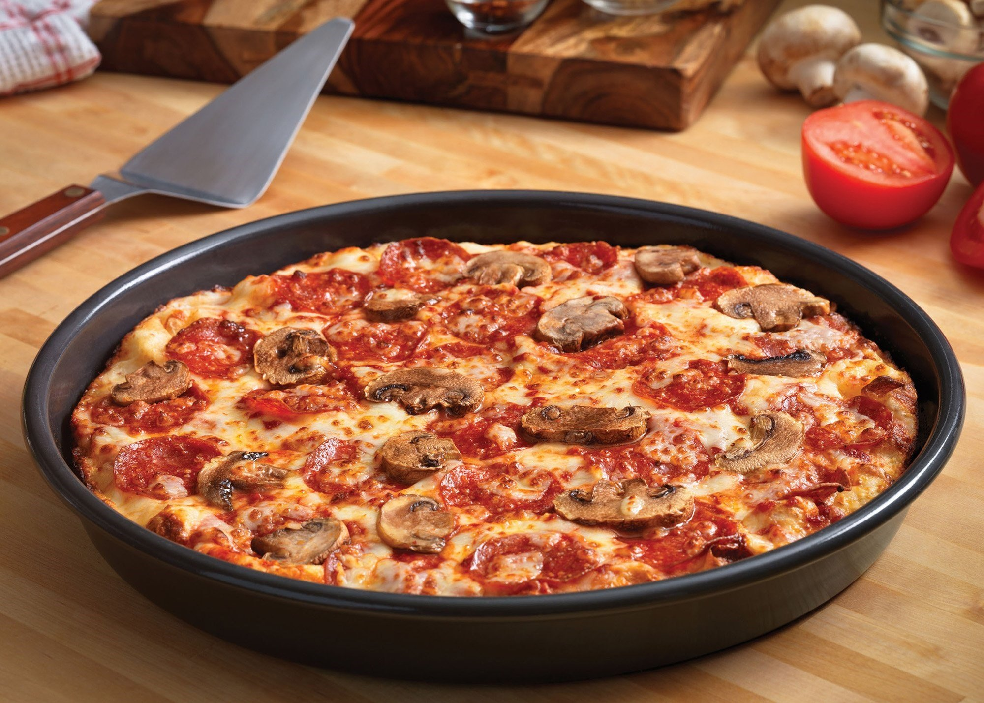 Domino's focuses on creating new tech and then develops engaging advertising around it to connect with customers and stand out in a fragmented field with national chains, regional stores and independent players. Seen here is Domino's pan pizza. (File...