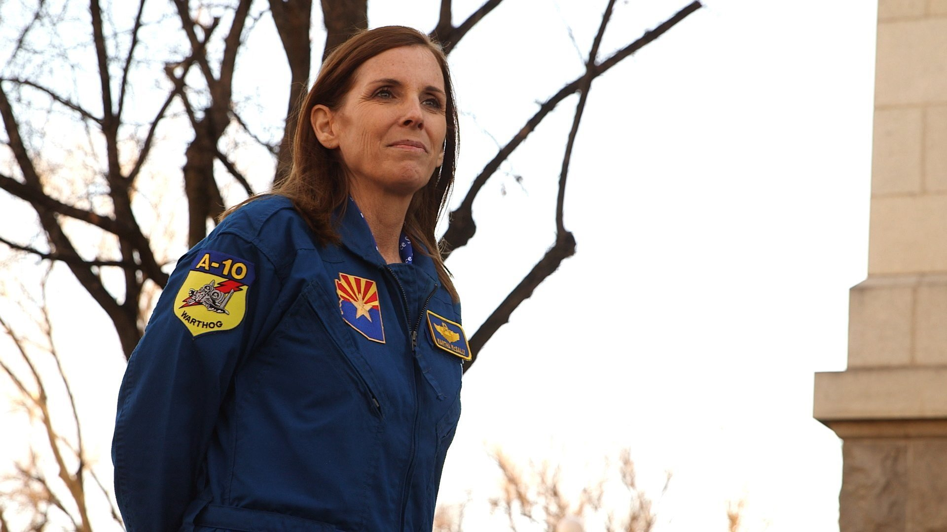 Dressed in a blue flight suit adorned with a US flag and her name, Martha McSally, the US Congresswoman representing this Tucson, Arizona crowd, scanned the airline hangar filled with supporters. Saluting, as the retired Colonel is well accustomed to...
