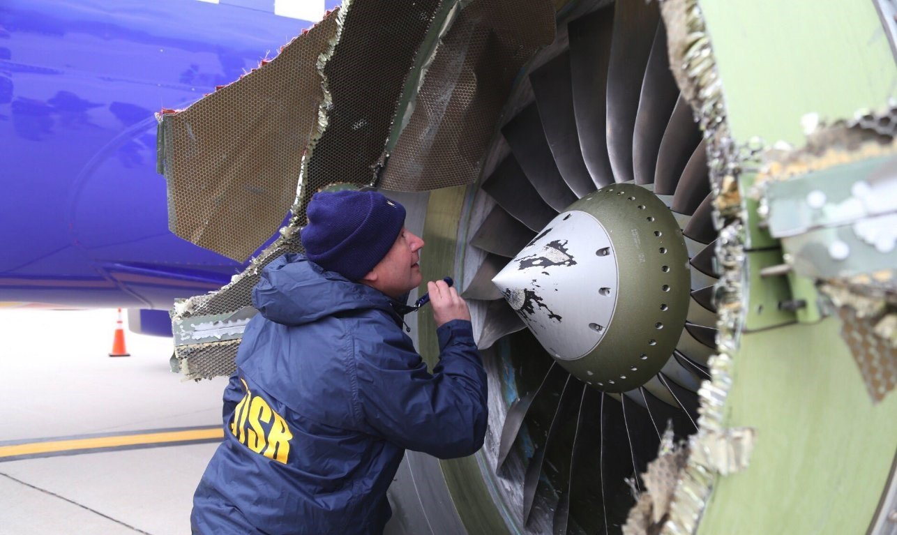 Woman sucked out of plane: Hundreds of emergency jet engine inspections ordered