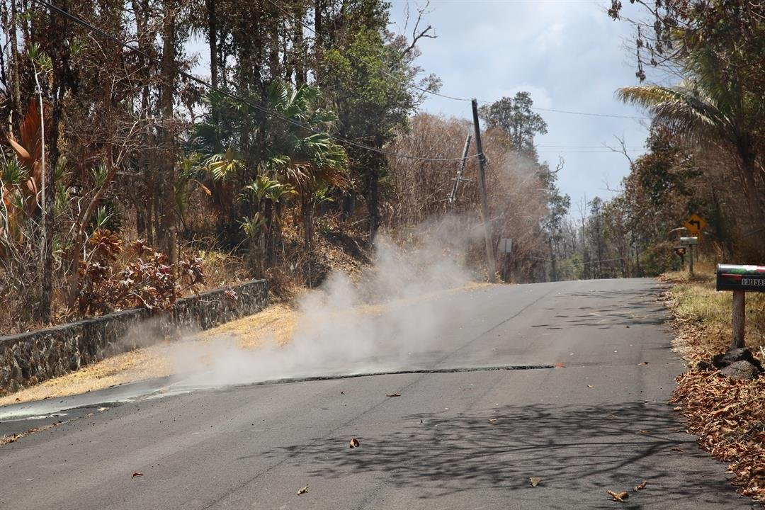 Toxic sulfur dioxide seeps out of the street in Leilani Estates, Hawaii.