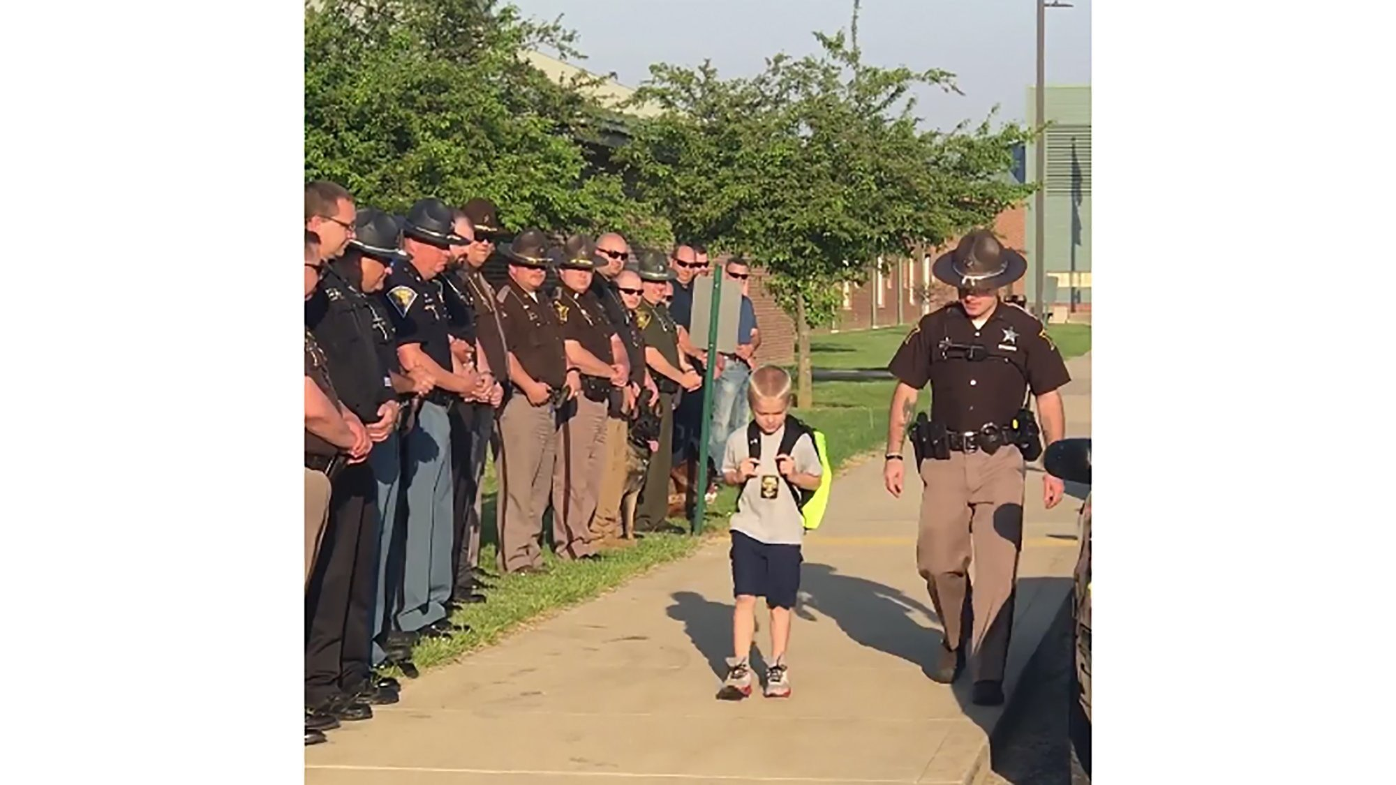 When Dakota Pitt's, 5, returned to school at Sullivan Elemntary School in western Indiana, for the first time after his police officer dad's death, 70 cops stood beside him  Credit: Samantha Phegley/Sulivan Elementary School