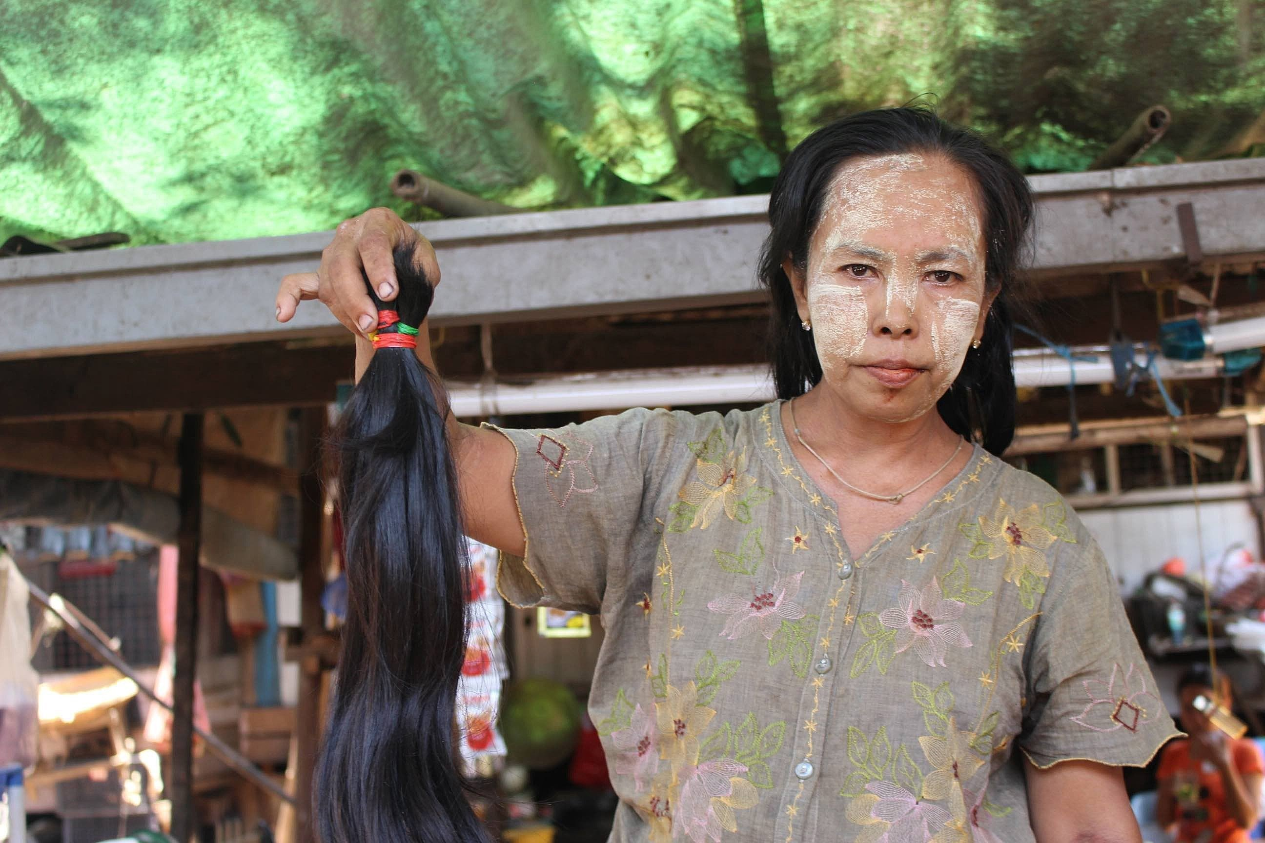 Aye Aye Thein, 55, cuts hair for a living at Insein market in the north of Yangon, Myanmar's largest city.