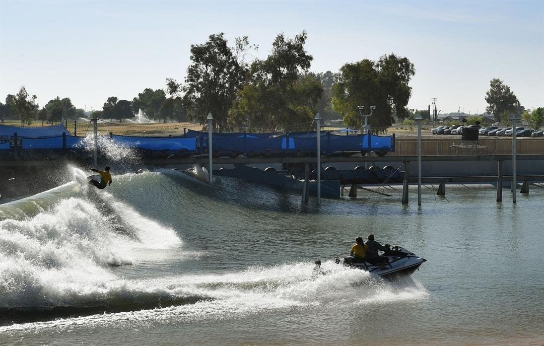 Brazil's Gabriel Medina rides towards the parking lot at Kelly Slater's Surf Ranch in Lemoore.