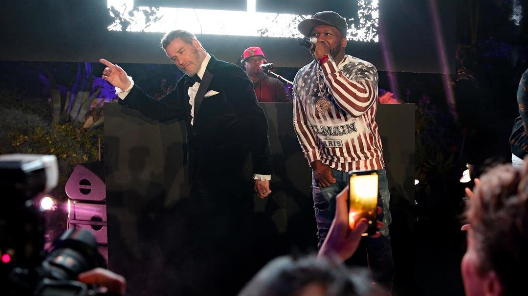 John Travolta and rapper 50 Cent on stage during the 71st annual Cannes Film Festival.
