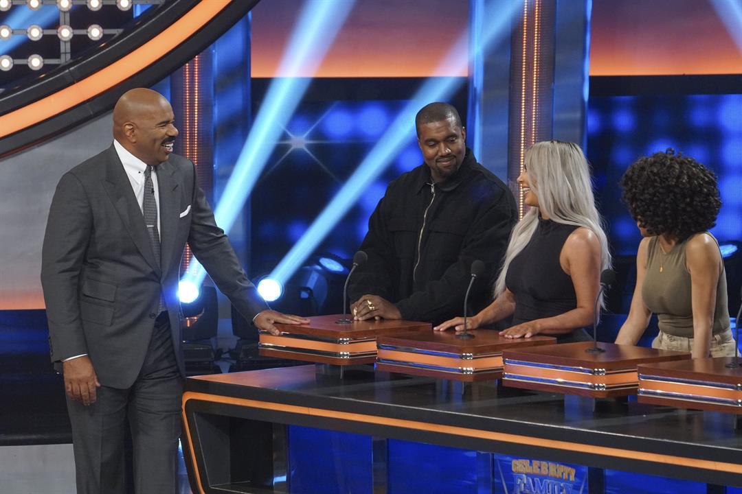 """Host Steve Harvey presides over The Kardashian Family vs. The West Family on """"Celebrity Family Feud."""""""