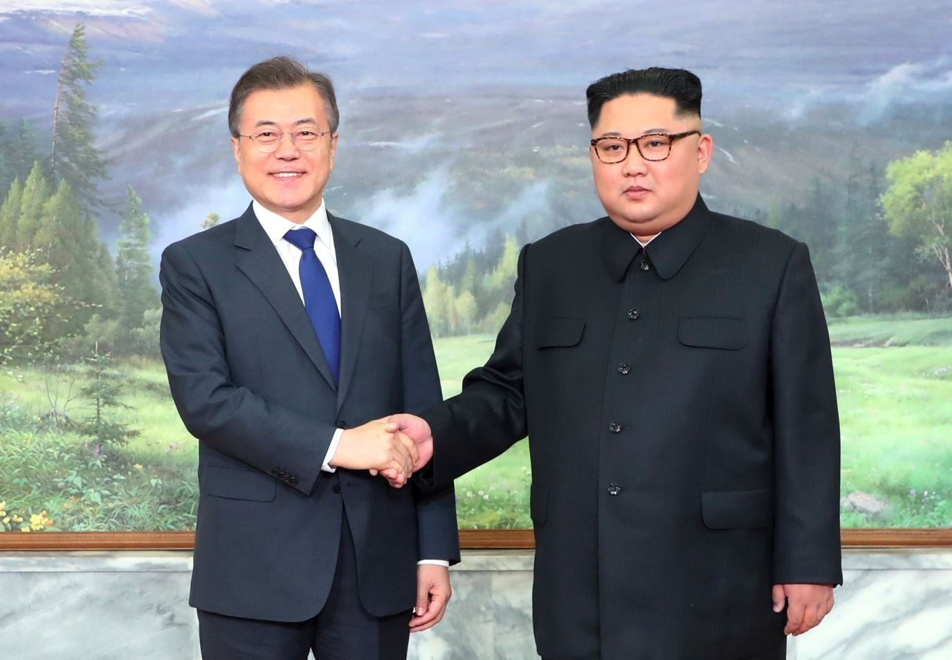 The North and South Korean leaders greet each other before Saturday's meeting.  CREDIT: South Korea Presidential Blue House/Yonhap via AP