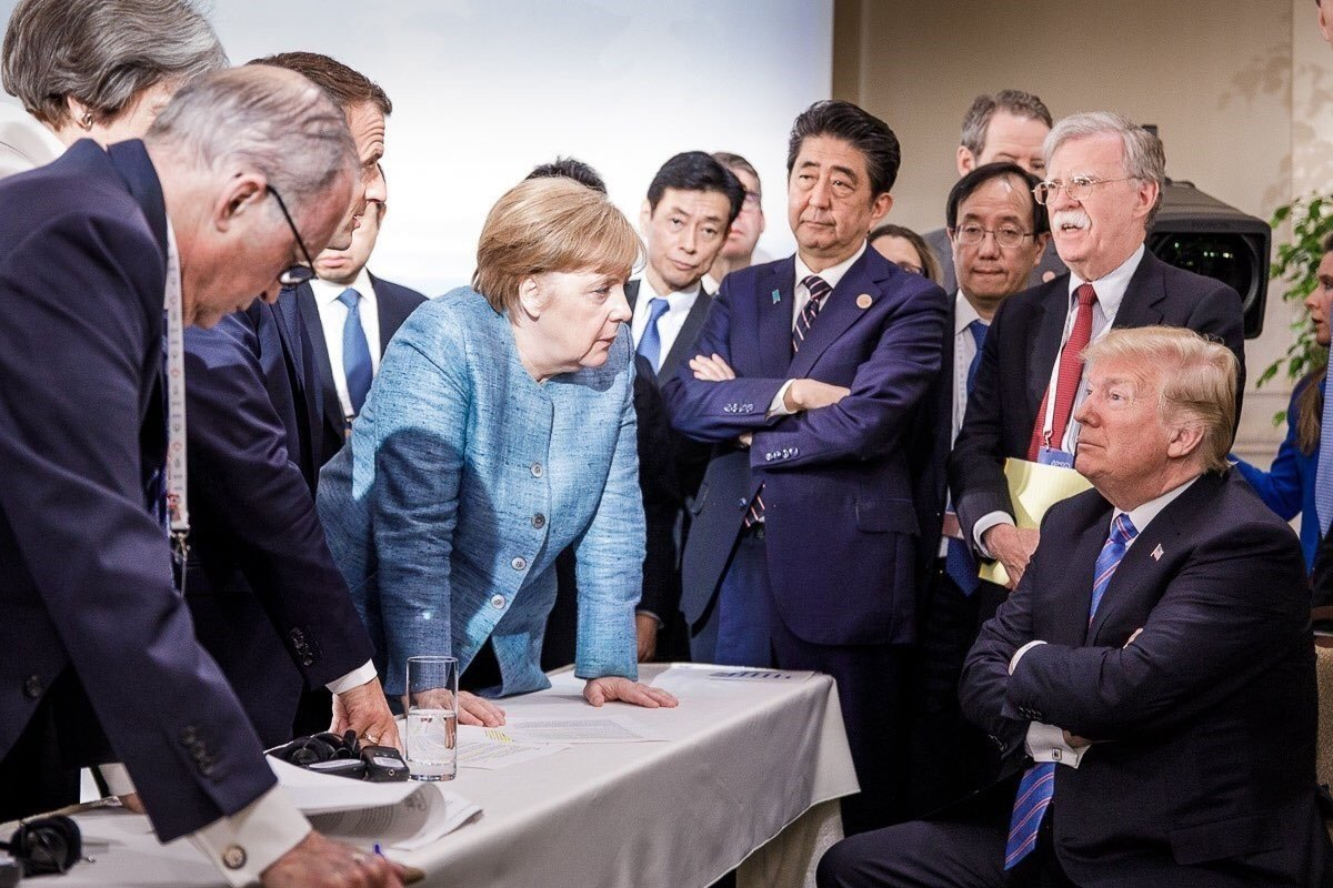 Seen here is German Chancellor Angela Merkel and President Trump surrounded by the leaders of other G7 countries. CREDIT Steffen Seibert  German Federal Press Office