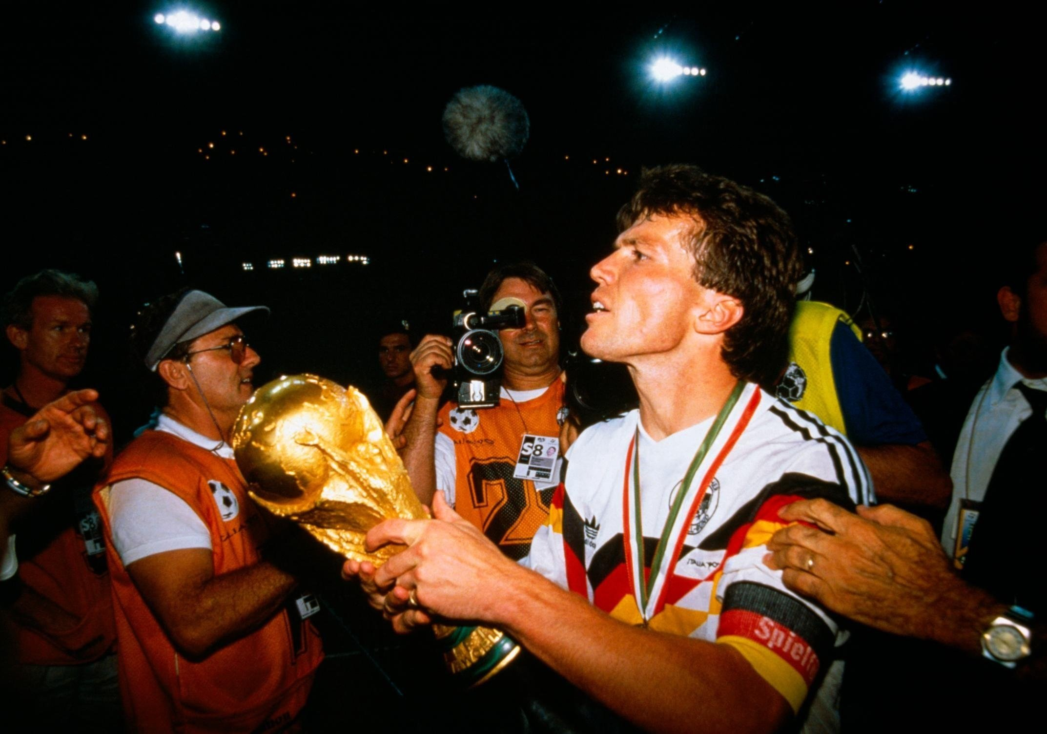 Germany captain Lothar Matthäus holds aloft the World Cup trohpy after defeating Argentina 1-0 in 1990.  CREDIT: Jean-Yves Ruszneiwski/Corbis Historical/VCG via Getty Images