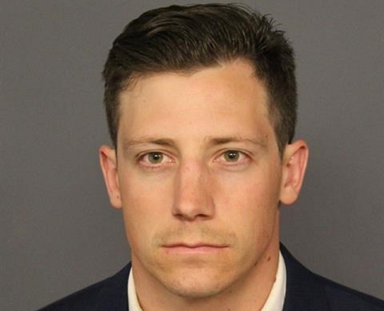 The FBI agent who unintentionally shot someone while dancing in a Denver bar turned himself in to police on Tuesday and is awaiting charges.