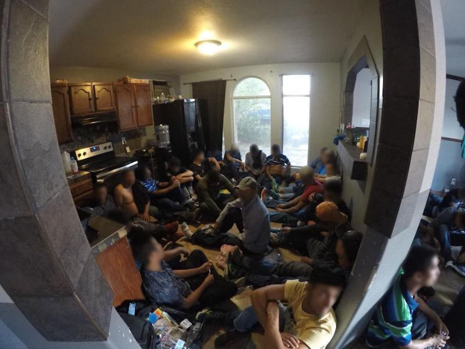 Border Patrol agents, acting on a tip, arrested 62 undocumented immigrants found in a two-bedroom house in Laredo on Tuesday.