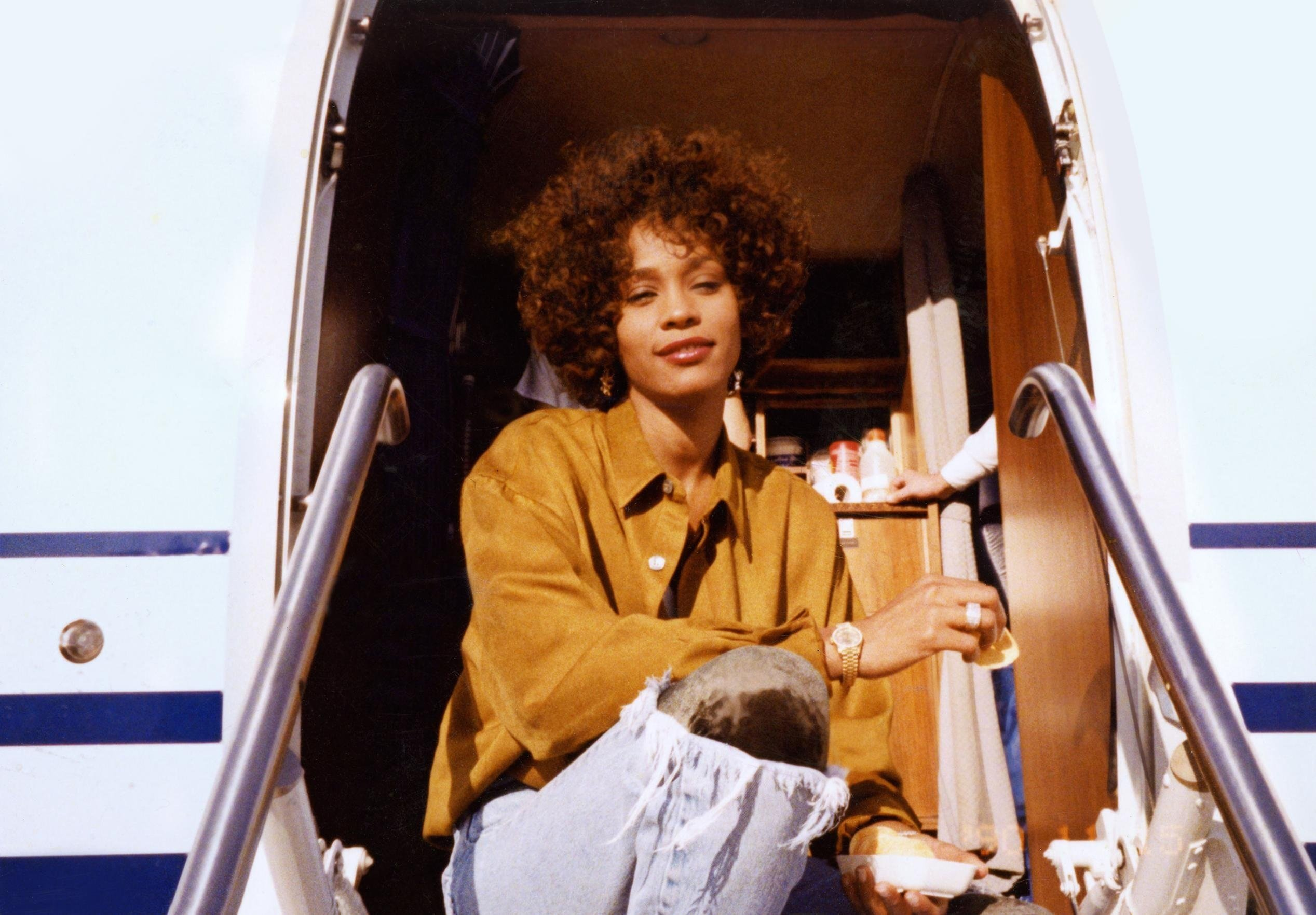 """""""Whitney,"""" the second feature-length Whitney Houston documentary in 10 months, has the advantage of being produced with cooperation from Houston's estate, providing greater access to those closest to her, including multiple relatives.   Full Credit:..."""
