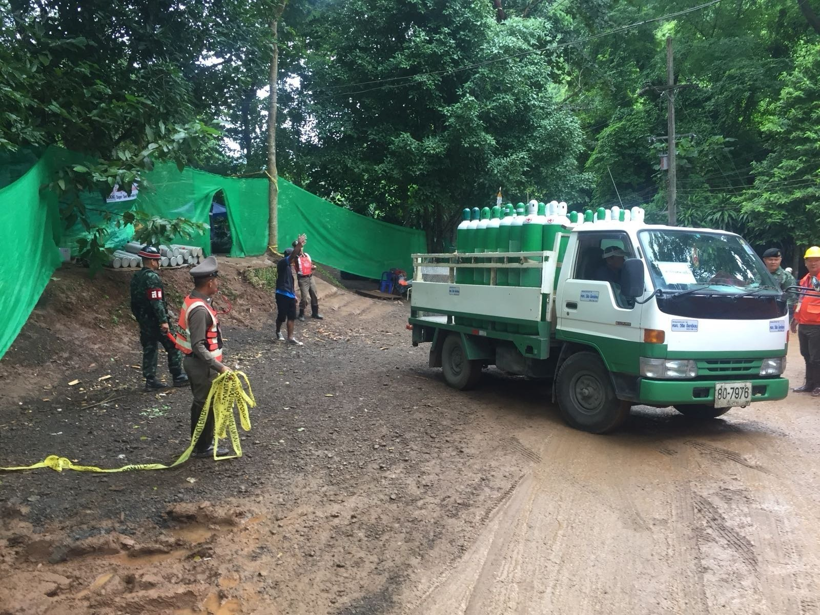 Oxygen being delivered to the entrance of the site, and military police sealing off cave site.