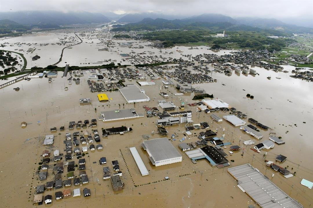 Flooding has killed at least eight people and forced 2 million others to flee their homes Saturday as heavy rain pounded large areas in southwestern Japan.  Credit:Shingo Nishizume/Kyodo News via AP