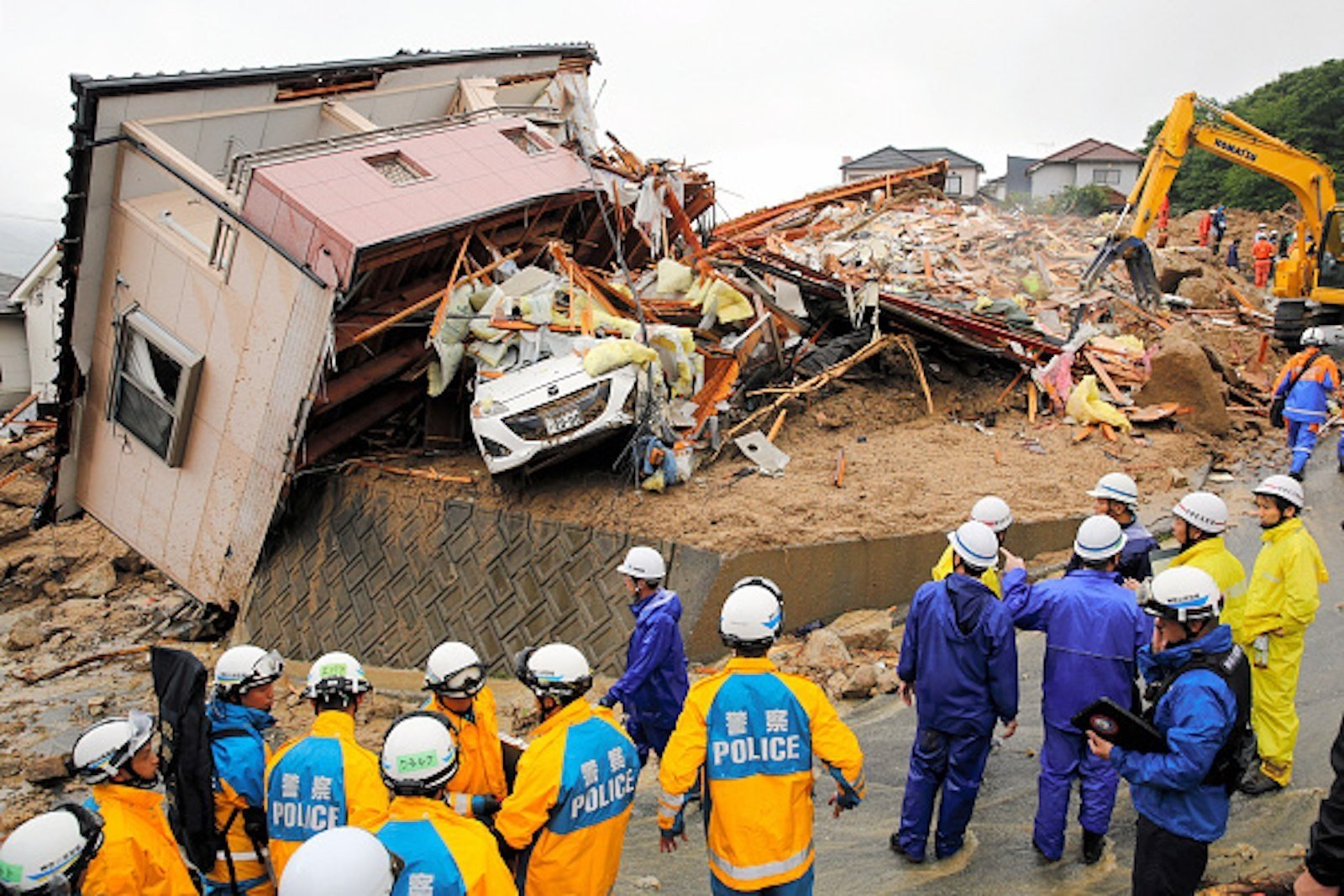Rescue operations continue at a collapsed house on July 8, 2018 in Kumano, Hiroshima, Japan.  CREDIT: The Asahi Shimbun via Getty Images