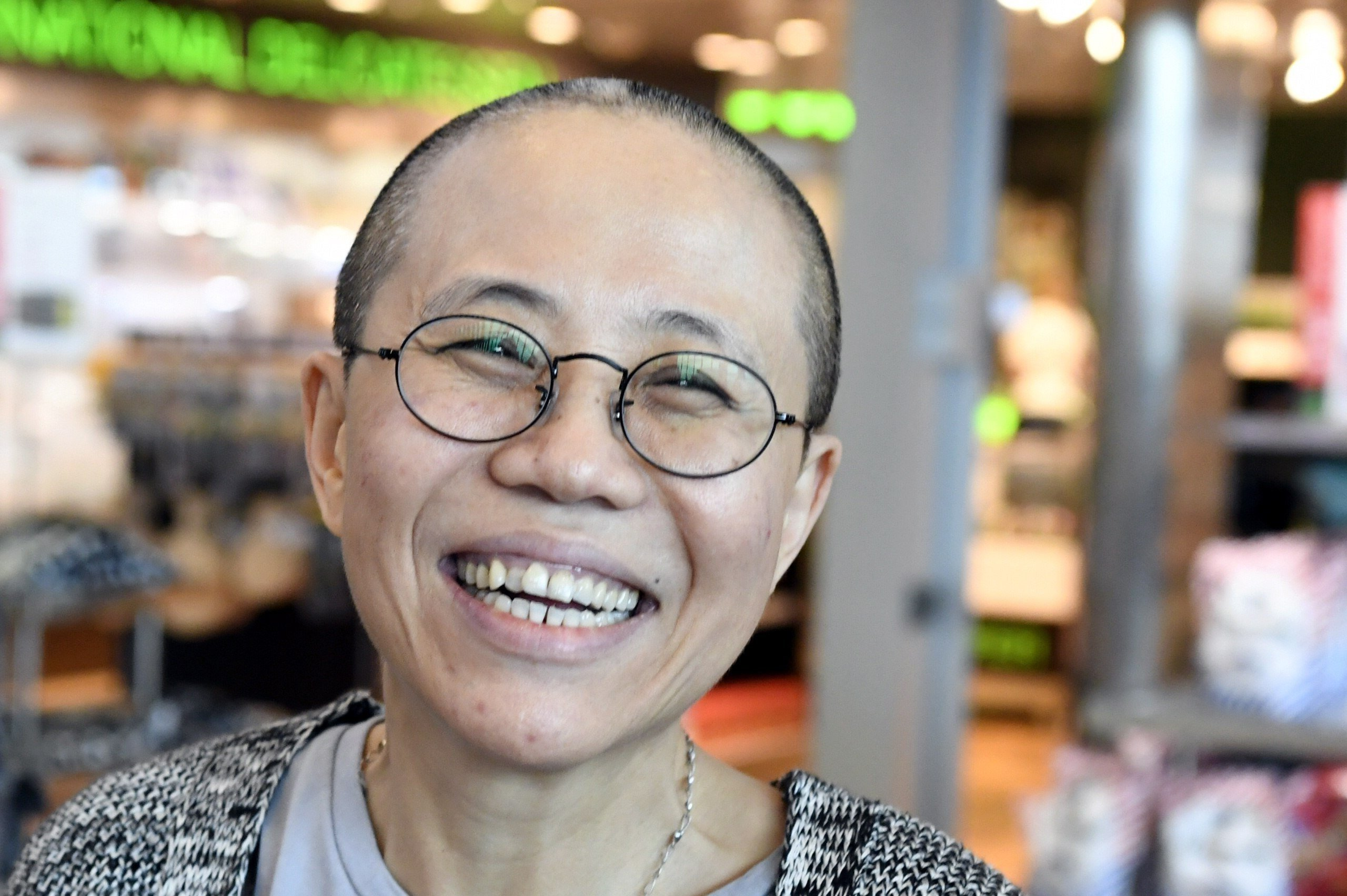 Liu Xia on her arrival in Finland. Despite facing no charges, the 57-year-old poet had endured heavy restrictions on her movements since 2010 when her husband won the Nobel Peace Prize.