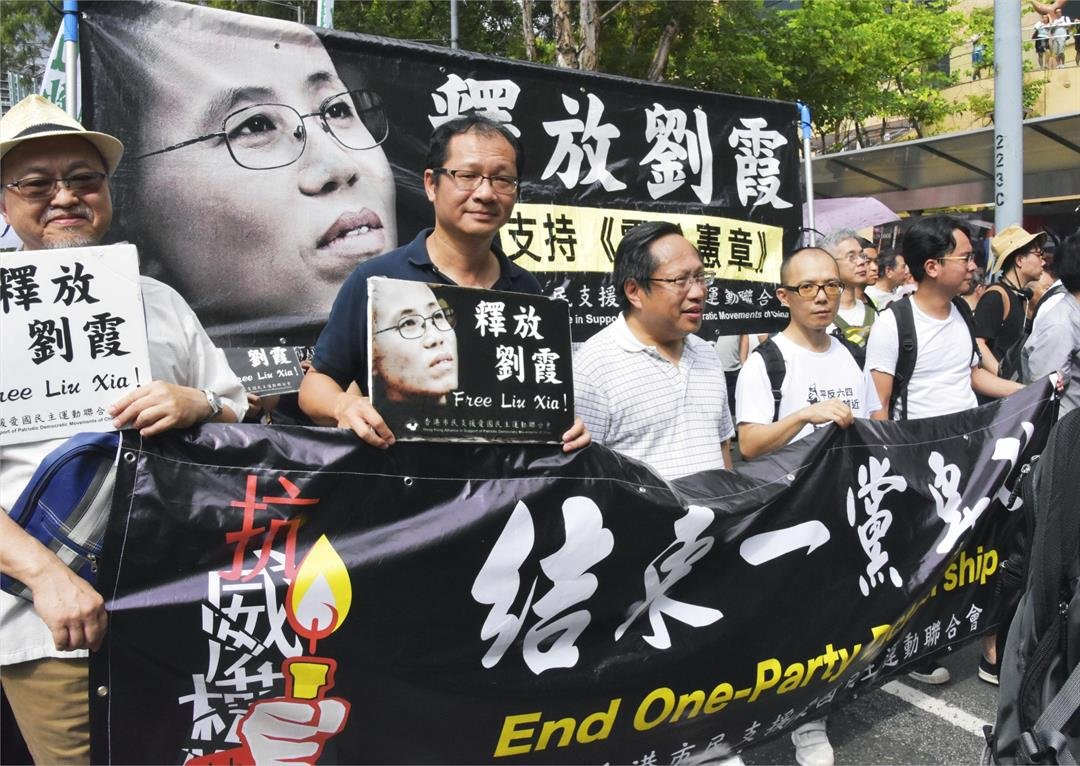 People march in Hong Kong in democracy protest on July 1, 2018, calling on China to release Liu Xia, the widow of China's late Nobel Peace Prize laureate Liu Xiaobo, who has been under house arrest for years.  CREDIT: Kyodo News via Getty Images