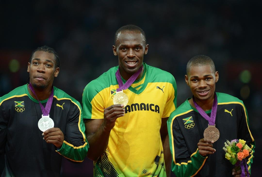 Weir (right) was part of a Jamaican clean sweep in the 200m at the 2012 Olympics.