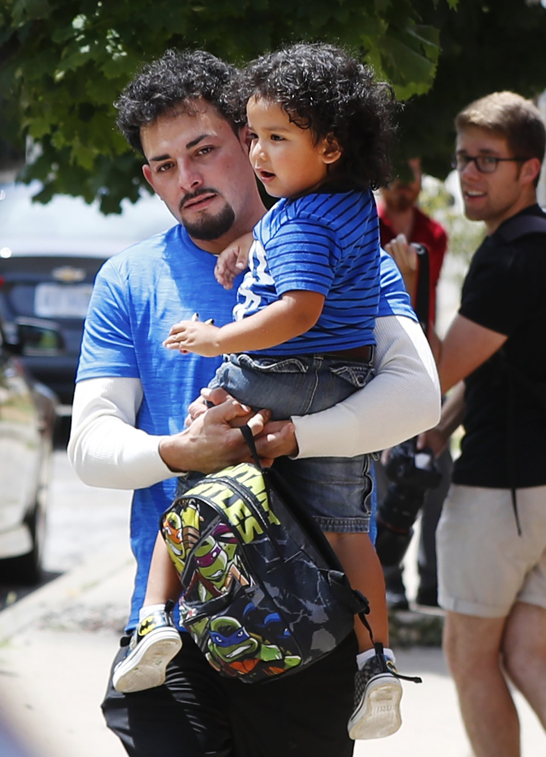 Ever Reyes Mejia, of Honduras, is reunited with his son at a U.S. Immigration and Customs Enforcement in Michigan.