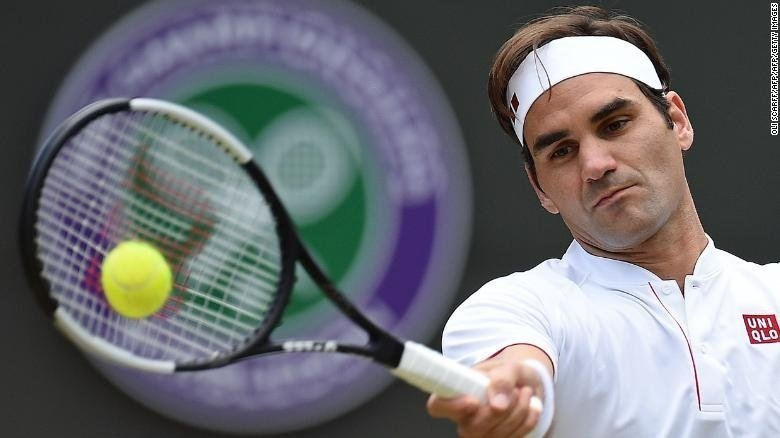 In unfamiliar surroundings at Wimbledon, Roger Federer suffered an unfamiliar defeat Wednesday against a big server who just didn't flinch.